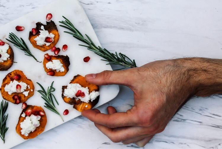 hand grabbing sweet potato chip