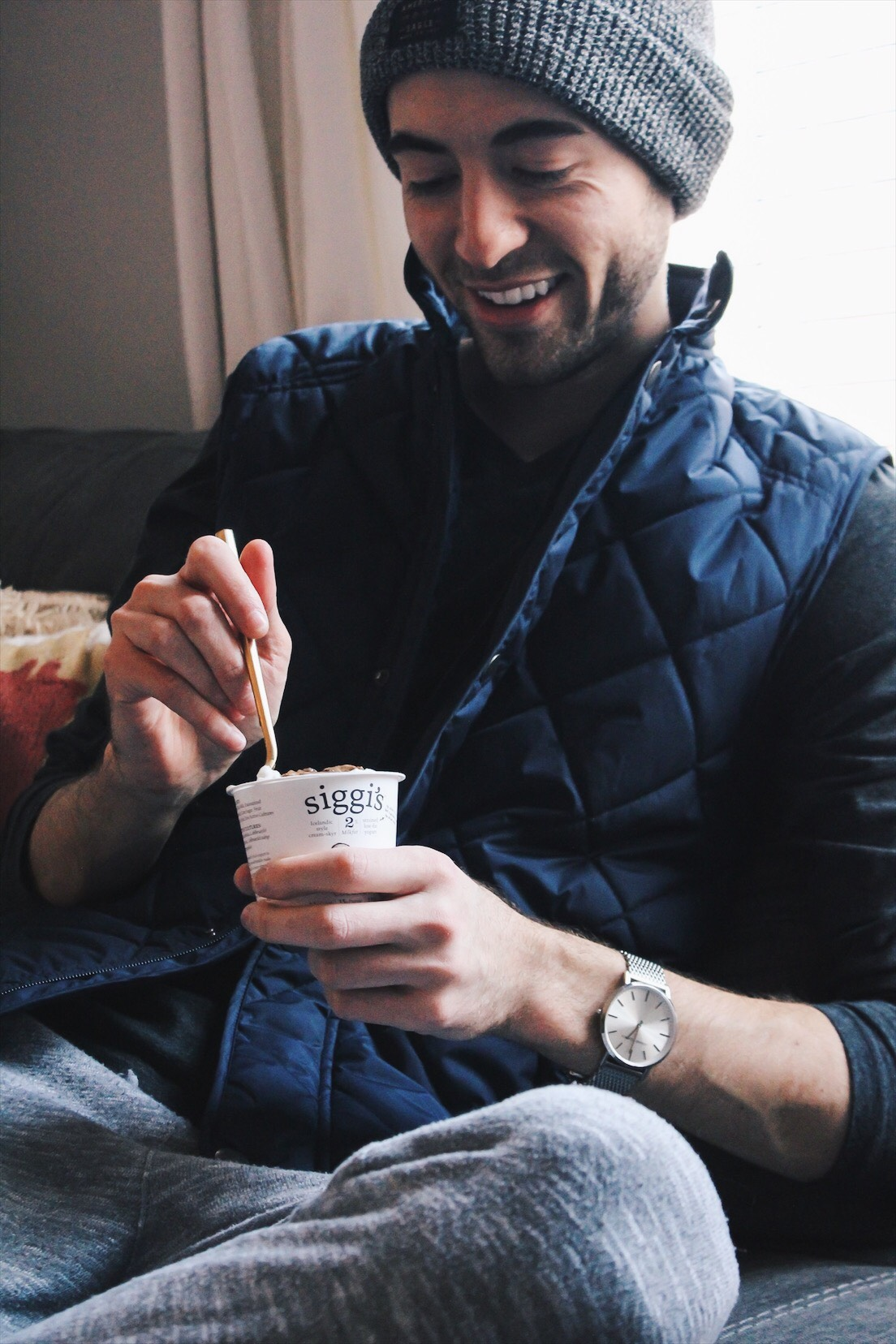 alex holding siggis yogurt