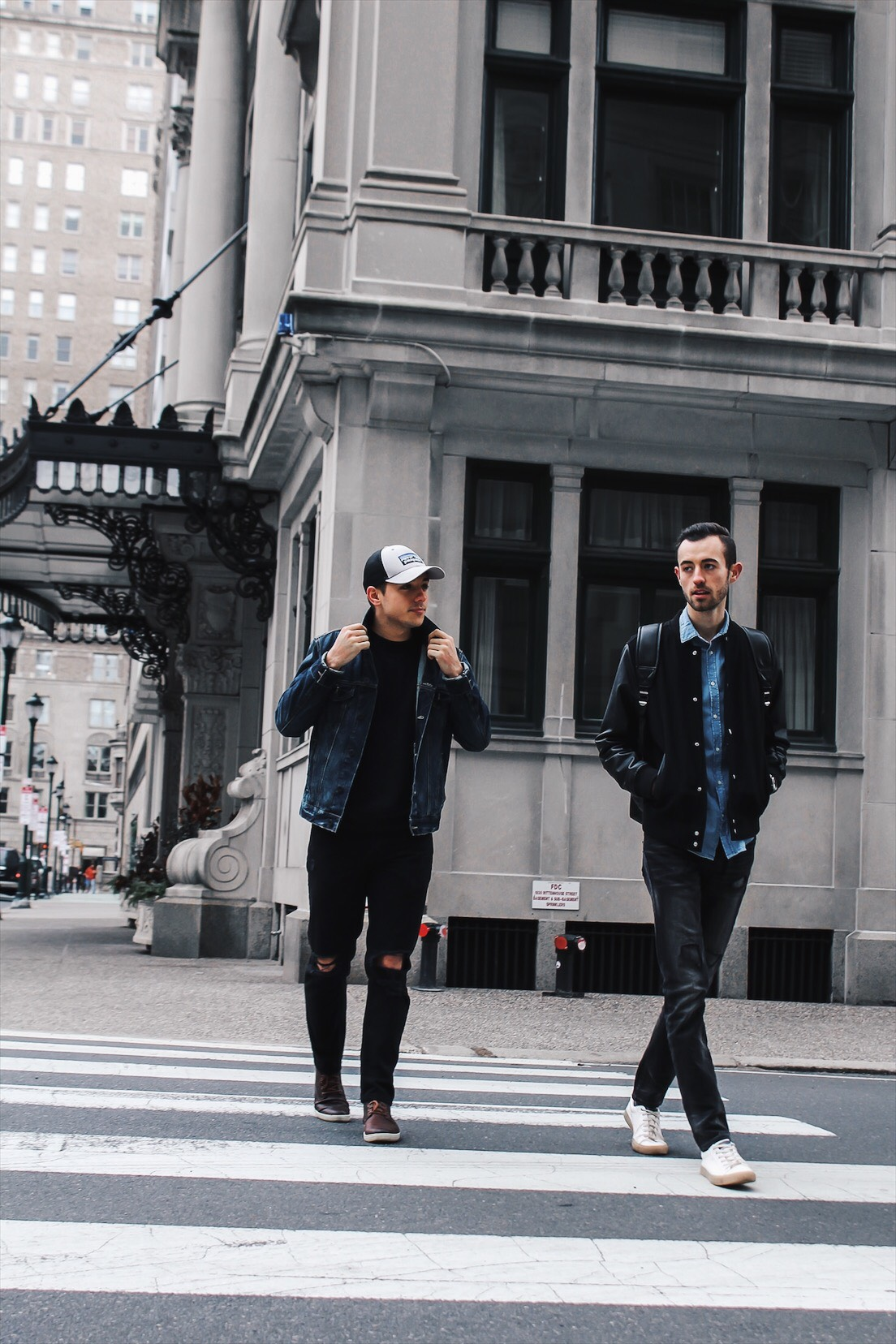 alex and mike crossing street in center city