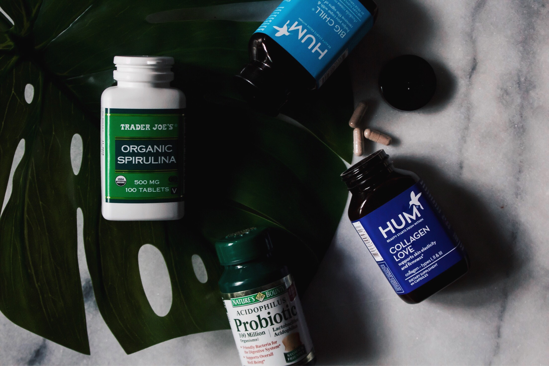 flatlay of 4 vitamins and supplements